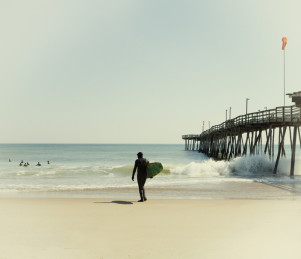 Surfers off of Avalon Fishing Pier in Outer Banks North Carolina