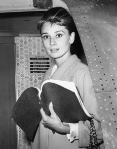 Audrey Heburn, with her script for BREAKFAST AT TIFFANY'S, returning to Los Angeles from New York lo